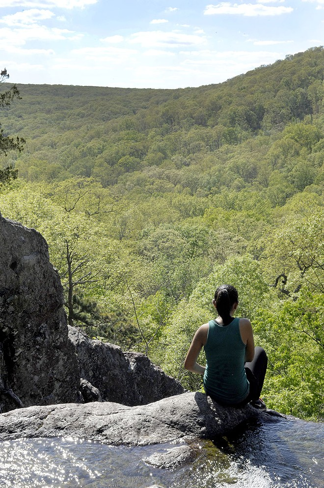A hiker contemplates the view - PHOTO BY KELLY GLUECK