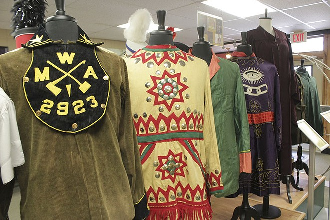 The DeMoulin Museum displays a number of vintage attire and uniforms from fraternal and secret societies. - PHOTO BY ALLISON BABKA