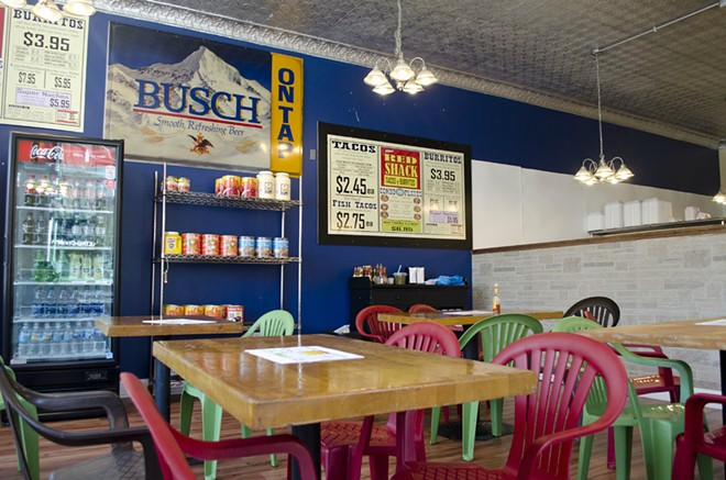 The inside of The Red shack is simple. Plenty of seating is offered and orders are taken over-the-counter. - KAVAHN MANSOURI