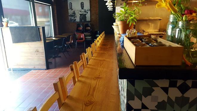 VISTA's ramen bar serves as an observation deck into the restaurant's kitchen. - KAVAHN MANSOURI