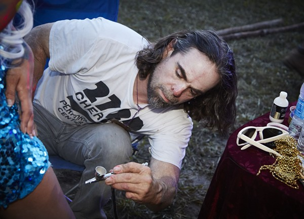 Davide Weaver at work on his installation. - PHOTO BY STEVE TRUESDELL