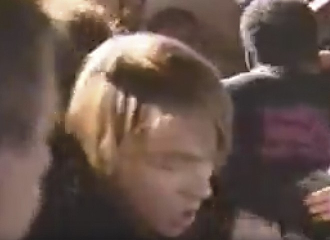 The band had played thirteen songs over 83 minutes before Rose jumped into the audience. - SCREENSHOT FROM VIDEO