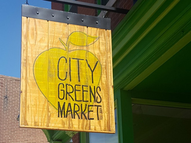 City Greens Market came to the Grove two years ago, after moving out of Midtown Catholic Charities' basement. Co-director Dylan Naylor hopes to reopen the market this month after losing funding from the charity. - KAVAHN MANSOURI