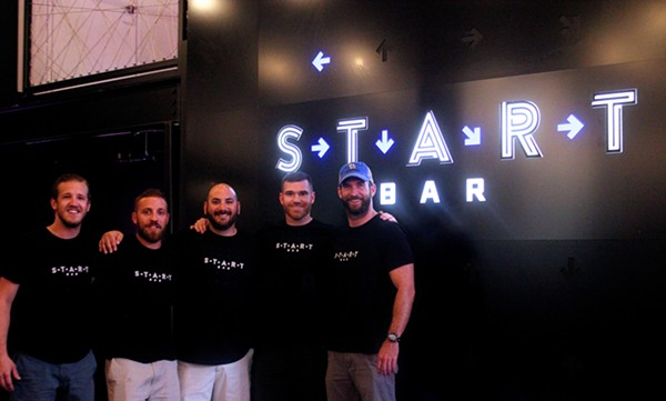 Chef Nick Del Gaiso (center) cracks a smile with Start Bar owners and contributors. - PHOTO BY NATALIE RAO