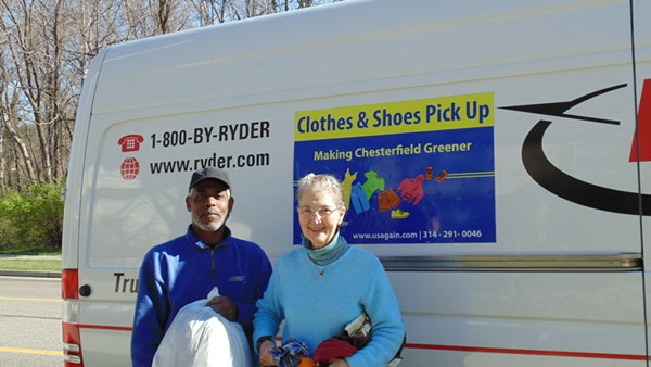 Chesterfield resident Darcy Capstick gives used clothing to a USAgain driver during one of the city's first-ever textile pickups. - PHOTO COURTESY OF JERRY BARTLEY