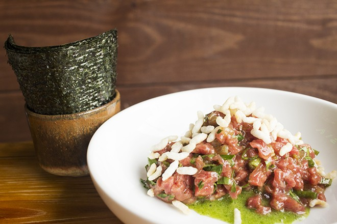 Beef tartare with parsley, fermented garlic, pickles and nori. - PHOTO BY MABEL SUEN