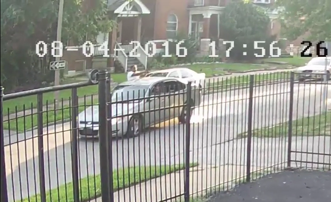 A gunman opens fire during an August 4 drive-by shooting in north St. Louis. - IMAGE VIA SLMPD/YOUTUBE