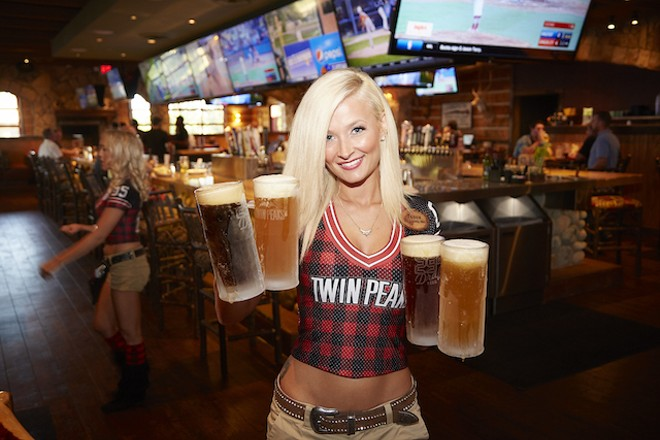 Twin Peaks is known for its comely servers — and ice cold beer. - PHOTO BY STEVE TRUESDELL