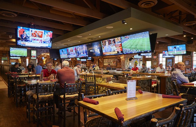 A former Macaroni Grill, the place now looks like a bit like an upscale ski lodge ... as well as a bar for serious sports fans. - PHOTO BY STEVE TRUESDELL