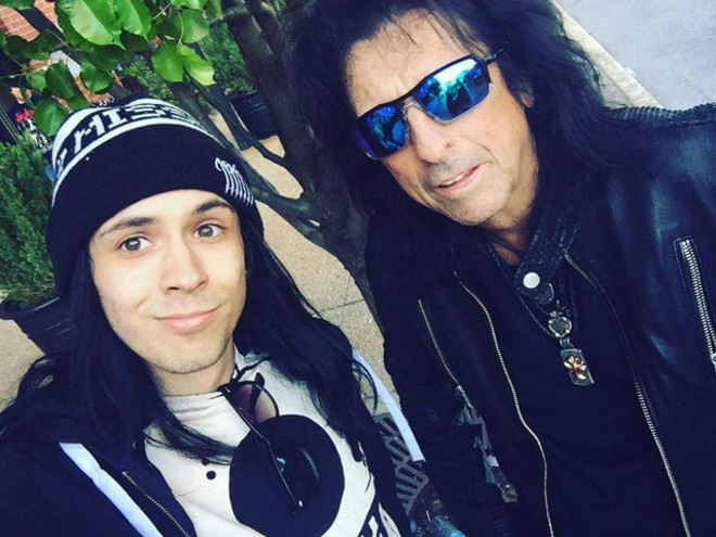 Krystofer Batsell, shown with Alice Cooper, interviewed rock stars for his site. - FACEBOOK