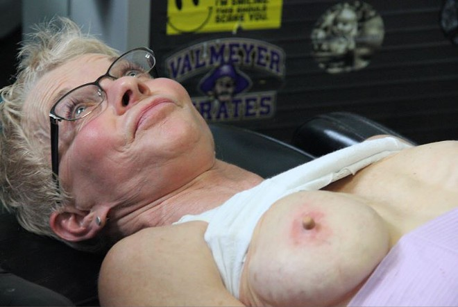 Catalano attaches a generic nipple to Kilhoffer's right breast. Later, she'll be given a custom-made nipple to match her existing one.