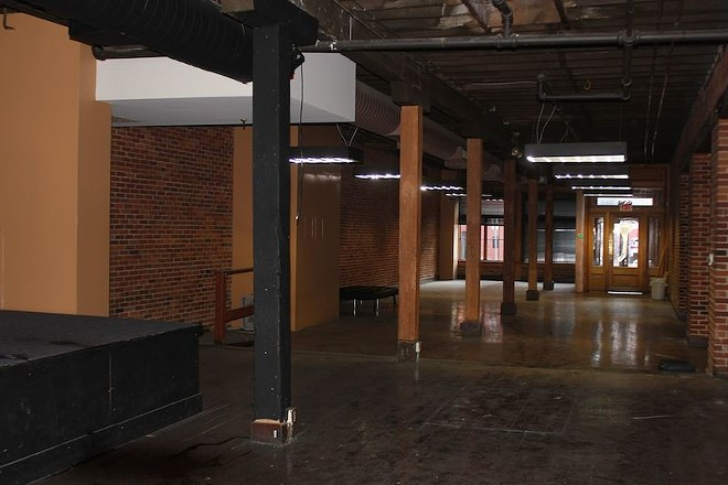 The second floor space includes classic exposed brick walls and wood floors. - PHOTO BY SARAH FENSKE