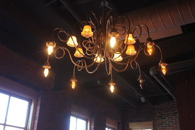 A third-floor chandelier. - PHOTO BY SARAH FENSKE