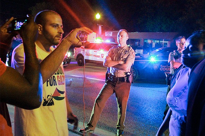 Bassem Masri, left, was a notable livestreamer during the Ferguson protests of 2014. - DANNY WICENTOWSKI