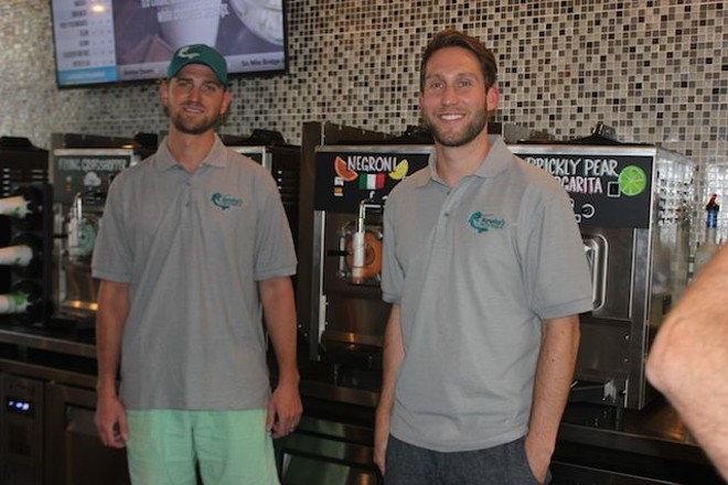 Brandon Holzhueter (left) and Brad Merten perfected their drinks at home around the kitchen table. - PHOTO BY SARAH FENSKE