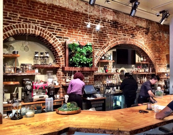 BRICK ARCHWAYS BEHIND THE LIVE-EDGE BAR | SARA GRAHAM