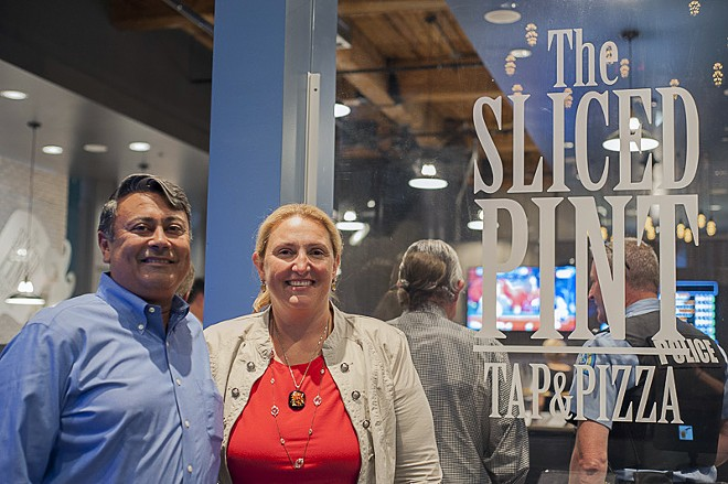 Owners Amrit and Amy Gill. The developers specialize in historic renovation and also own O'Shay's Pub in the Grove. - PHOTO BY KELLY GLUECK