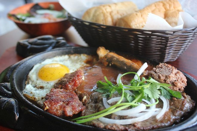 The sizzling steak — a house specialty, and relatively uncommon in the Midwest. - PHOTO BY SARAH FENSKE
