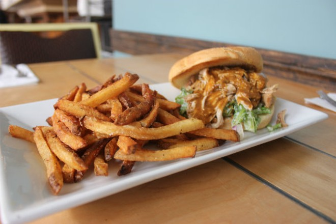 The pulled pork sandwich with hand cut fries. - CHERYL BAEHR