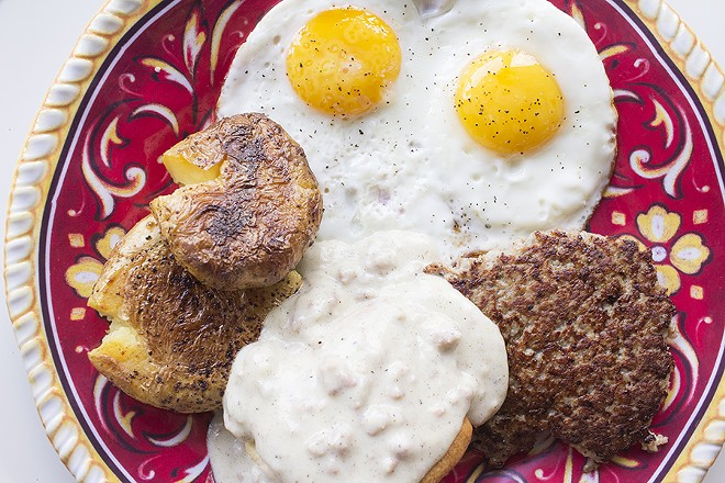 """The """"Classic Breakfast"""" comes with two eggs, bacon or sausage, smashed potatoes and a biscuit with gravy. - PHOTO BY MABEL SUEN"""