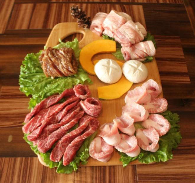 "The ""Beef and Pork"" combination platter includes kalbi, rib-eye, pork belly and pork jowl. - CHERYL BAEHR"