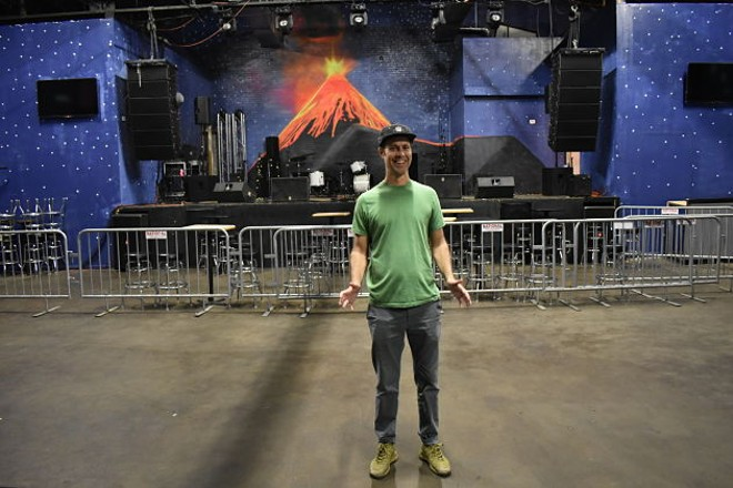 Josh Loyal shows off the huge stage and dancefloor of El Volcan. - DANIEL HILL