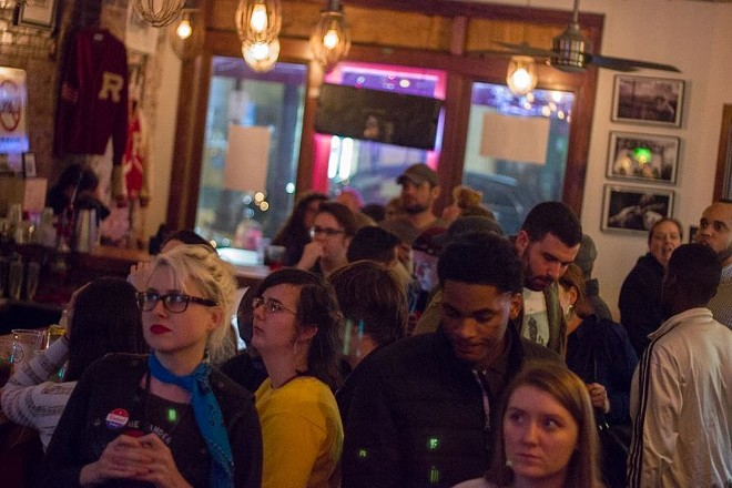 The crowd at Yaquis watch election results with mounting horror. - PHOTO BY DANNY WICENTOWSKI