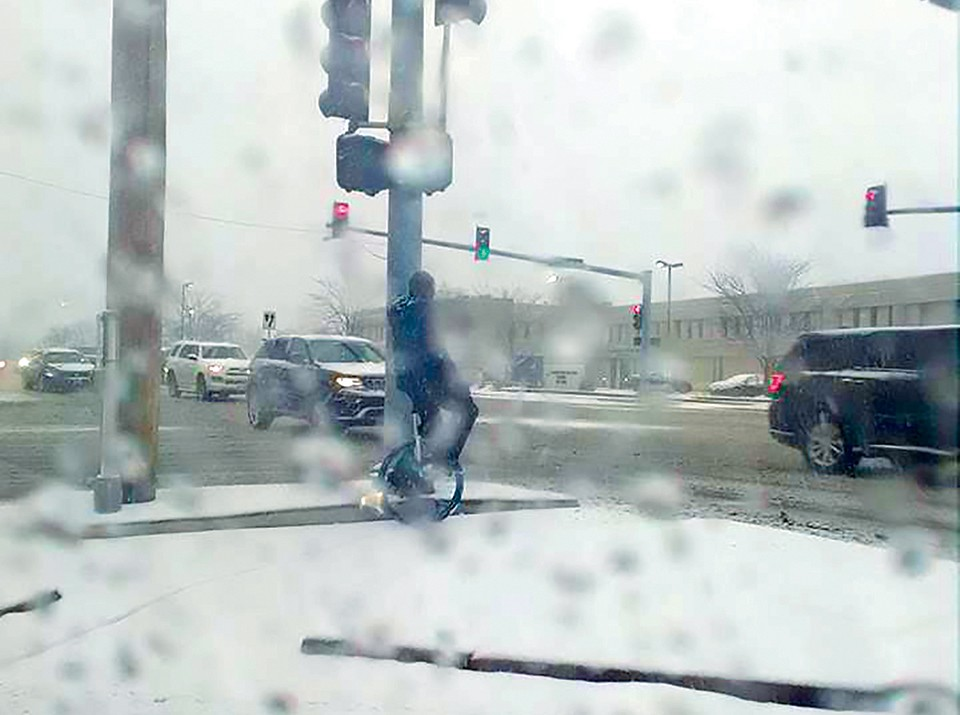 A passing driver took this photo as proof there really was a unicyclist in the snowstorm. - COURTESY JANE REDINGTON
