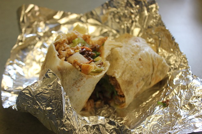 An Asian-style burrito, loaded with Peking duck, Asian vegetables and sesame sauce. - PHOTO BY SARAH FENSKE