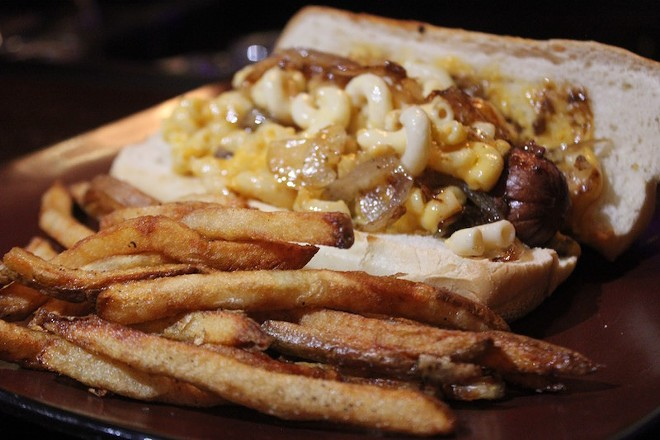 """The """"Second Line"""" dog is smothered with Andouille Gravy, creole mac n cheese, and fried onions. - PHOTO BY SARAH FENSKE"""