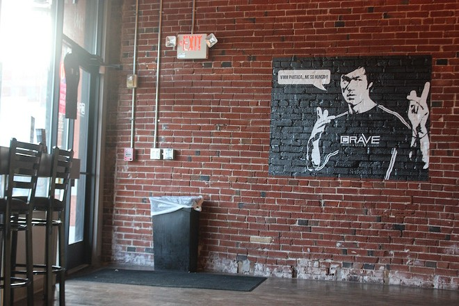 A mural beckons diners near the doorway. - PHOTO BY SARAH FENSKE