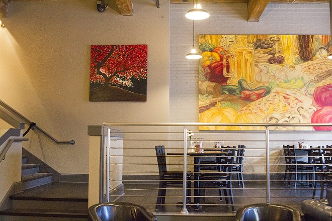 The work of local artists adorns the walls. - PHOTO BY MABEL SUEN
