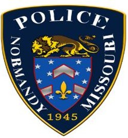 Normandy's public works director was charged with impersonating a police officer.