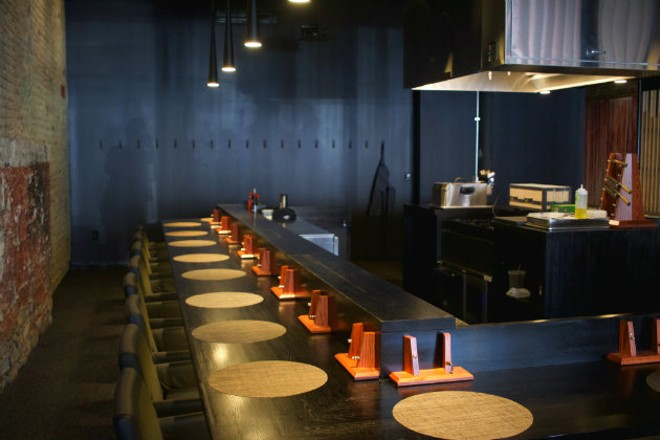 Diners sit around the kitchen for an interactive experience. - CHERYL BAEHR