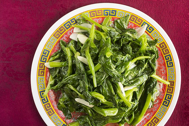 Snow pea tips: Snow pea leaves sautéed with garlic and sesame oil. - PHOTO BY MABEL SUEN