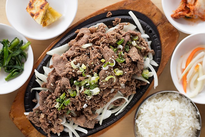 Bulgogi is a Korean BBQ dish featuring one pound of grilled thinly sliced prime ribeye beef marinated in savory or spicy sauce, served on a bed of onions. - MABEL SUEN
