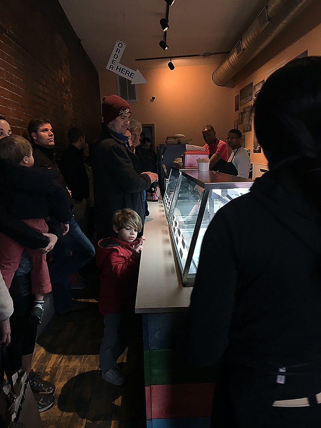 The small shop just has room for a line and then a few seats near the window. - PHOTO BY KELLY GLUECK
