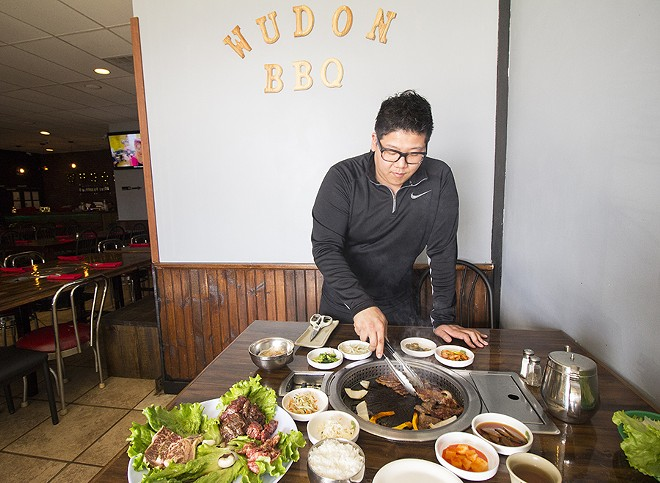 Co-owner Victor Jang shows off some tabletop grilling action. - PHOTO BY MABEL SUEN