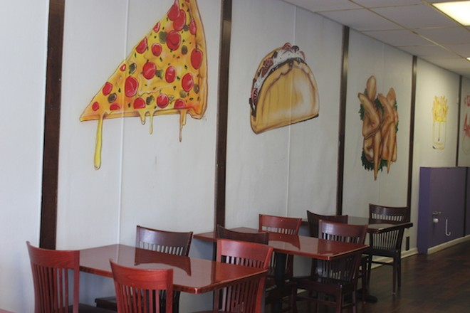 Painted tacos, pizza and wings ornament the walls. - SARAH FENSKE