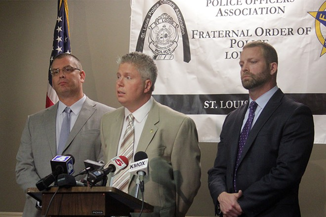 (Left to right) St. Louis Police Officer's Association President Joe Steiger, business manager Jeff Roorda and attorney Brian Millikan during an October 2014 press conference. - PHOTO BY DANNY WICENTOWSKI