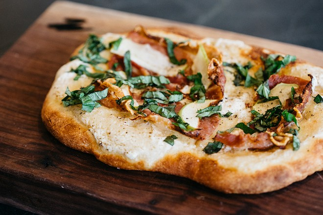 Flatbread topped with prosciutto, ricotta, apple and basil. - RJ HARTBECK