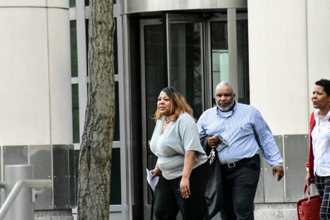 Former St. Louis Police Office Terri Owens (left) leaves federal  court on Tuesday with her family. - DOYLE MURPHY