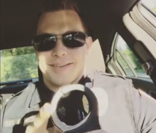 Ex-officer Mike Weston plays with his handcuffs in one of his Instagram posts. - INSTAGRAM