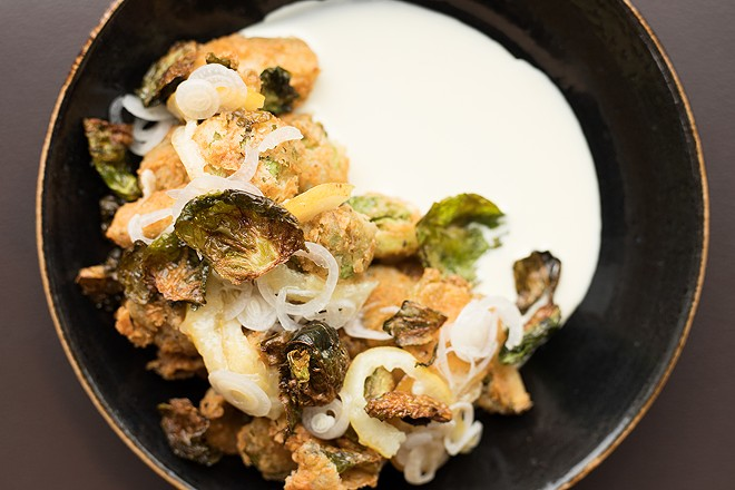 Chicken-fried Brussels sprouts are served with buttermilk dressing, confit lemon and pickled spring onions. - MABEL SUEN
