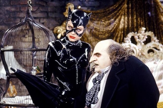 Catwoman and the Penguin (Michelle Pfeiffer and Danny DeVito)  plot to take down Batman in Batman Returns. - C) 1997 WBEI. TM & (C) DC COMICS/COURTESY OF FATHOM EVENTS
