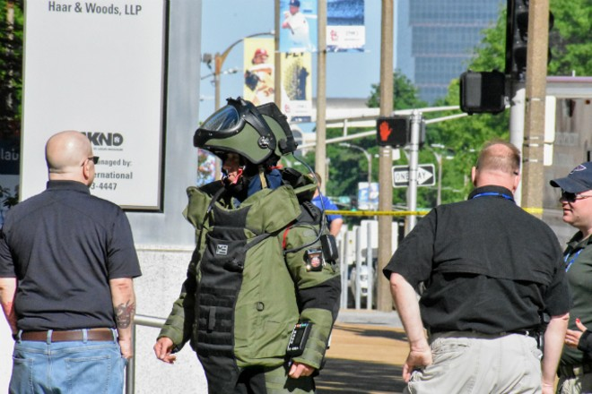 A member of the St. Louis Regional Bomb and Arson Unit waits outside KSDK on Tuesday morning. - DOYLE MURPHY