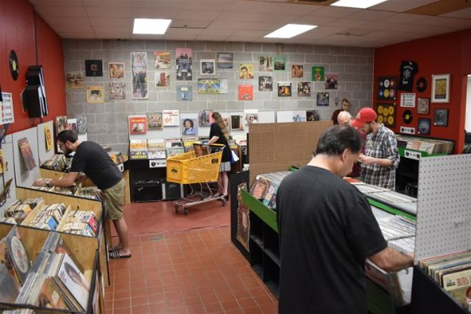 Vinyl enthusiasts dig through the crates at SOHO's grand opening. - DANIEL HILL