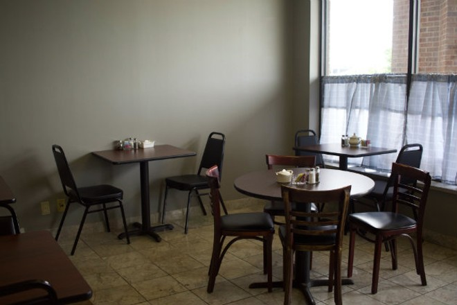 Esther's small dining room has approximately twelve tables. - CHERYL BAEHR