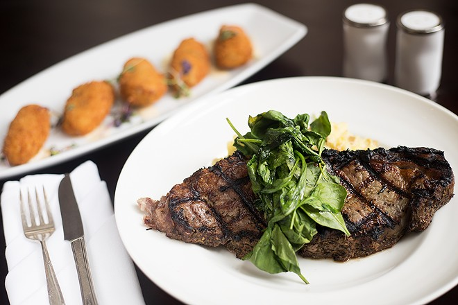 """The New York strip loin is cold-smoked at 75 degrees, then served with creme fraiche """"mashers"""" and vegetables. - MABEL SUEN"""
