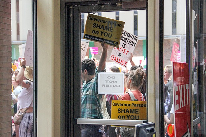 Protesters opposing new abortion restrictions gather outside the Wainwright Building last week. - DANNY WICENTOWSKI